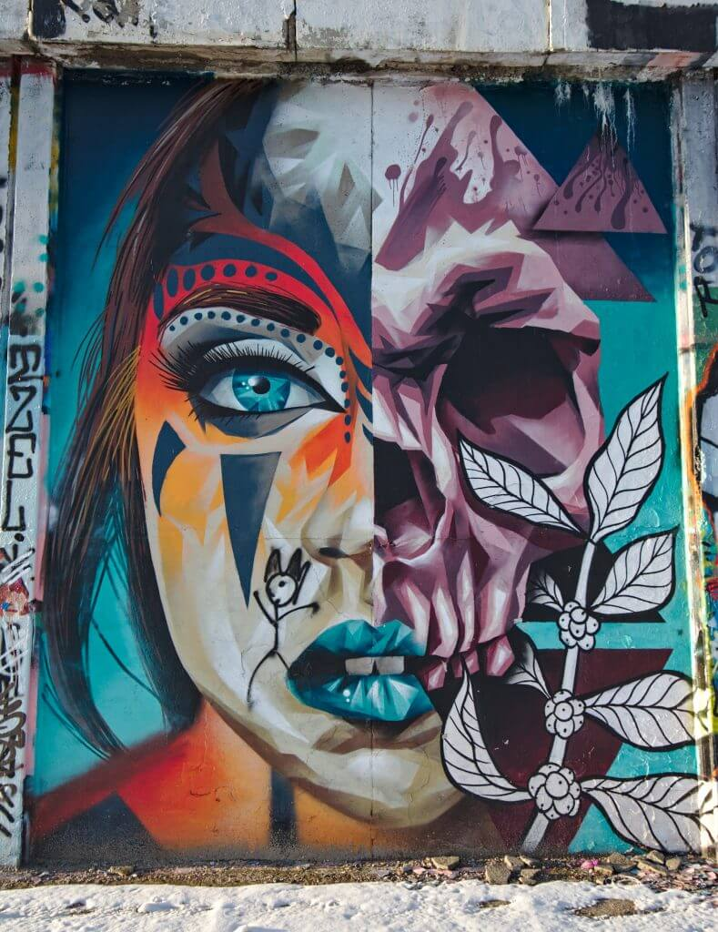 double face street art