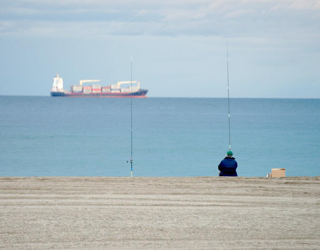 pecheur à la plage de Malagueta